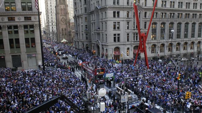 The New York Giants  make their way up Broadway during the team's NFL football Super Bowl parade in New York, Tuesday, Feb. 7, 2012. The Giants returned from their Super Bowl win to a celebration the likes that only New York can throw: a ticker-tape parade in the Canyon of Heroes on Broadway, where the city has honored stars for almost a century. (AP Photo/Seth Wenig)