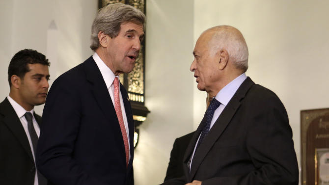 U.S. Secretary of State John Kerry, left, shakes hands for a photograph with Arab League Secretary General Nabil Elaraby, after their meeting in Cairo, Egypt on Saturday, March 2, 2013. Cairo is the sixth leg of Kerry's first official overseas trip and begins the Middle East portion of his nine-day journey. (AP Photo/Jacquelyn Martin, Pool)