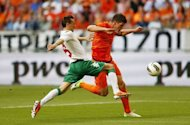 Dutch football player Klaas-Jan Huntelaar (R) fights for the ball with his Bulgarian opponent Nikolay Bodurov during a friendly football match at the Arena stadium in Amsterdam. Bulgaria won 2-1