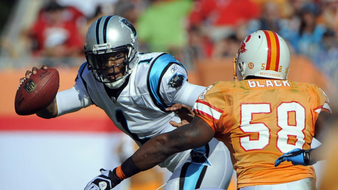 Carolina Panthers quarterback Cam Newton (1) eludes Tampa Bay Buccaneers outside linebacker Quincy Black (58) during the second quarter of an NFL football game on Sunday, Dec. 4, 2011, in Tampa, Fla. (AP Photo/Brian Blanco)