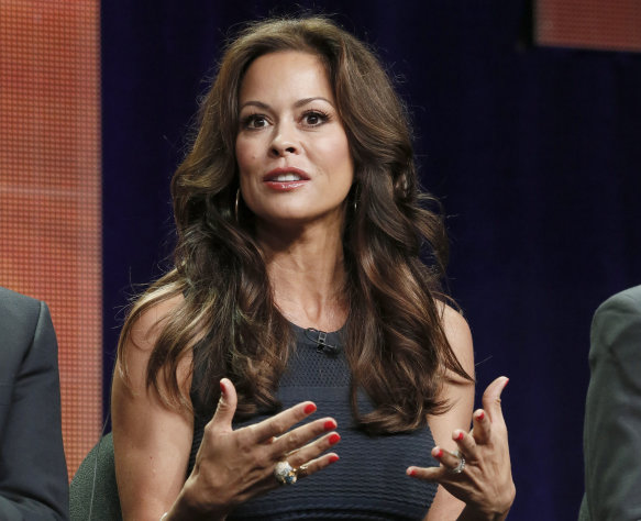 "FILE - This July 27, 2012 file photo shows TV host Brooke Burke-Charvet at the ""Dancing with the Stars: All Stars"" panel at the Disney ABC TCA Day 2 in Beverly Hills, Calif. Burke has posted a video message on YouTube disclosing that she has thyroid cancer and her plans for surgery to remove her thyroid. The 41-year-old mother of four says a lump on her thyroid was found during a routine biopsy. (Photo by Todd Williamson/Invision/AP, file)"
