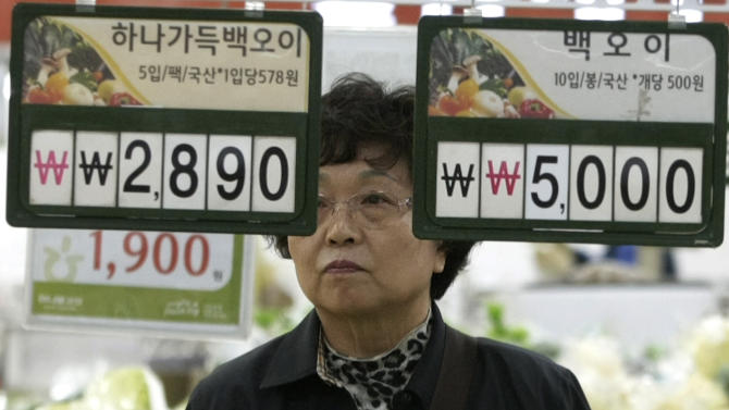 A customer looks at price tags at a store in Seoul, South Korea, Wednesday, April 13, 2011. South Korea's central bank raised its inflation forecast for this year on higher oil prices and rising food costs after a devastating outbreak of foot-and-mouth disease.(AP Photo/Ahn nYoung-joon)