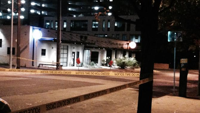 In this photo provided by Claudia Y Hernandez, police tape marks off the scene after authorities shot and killed a man who they say opened fire on the Mexican Consulate, police headquarters and other downtown buildings early Friday, Nov. 28, 2014, in Austin, Texas. The gunman fired more than 100 rounds at downtown buildings early Friday before he died, Austin authorities said.   (AP Photo/Claudia Y Hernandez)