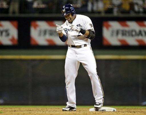 Milwaukee Brewers' Carlos Gomez reacts after hitting a two-run double during the fifth inning of a baseball game against the Los Angeles Dodgers Tuesday, May 21, 2013, in Milwaukee