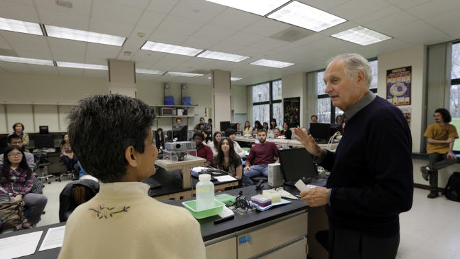 In this Friday, April 26, 2013 photo, actor Alan Alda enlists the help of Sujata Pawagi during a Communicating Science class on the campus of Stony Brook University, on New York's Long Island. The film and television star is trying to encourage scientists of all disciplines to ditch the jargon and speak in plain English. (AP Photo/Richard Drew)