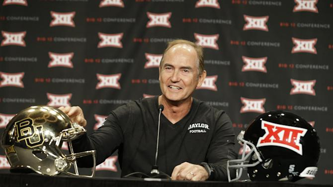 Baylor head coach Art Briles touches his teams' helmet while speaking to reporters during the NCAA college Big 12 Conference football media days in Dallas, Monday, July 21, 2014