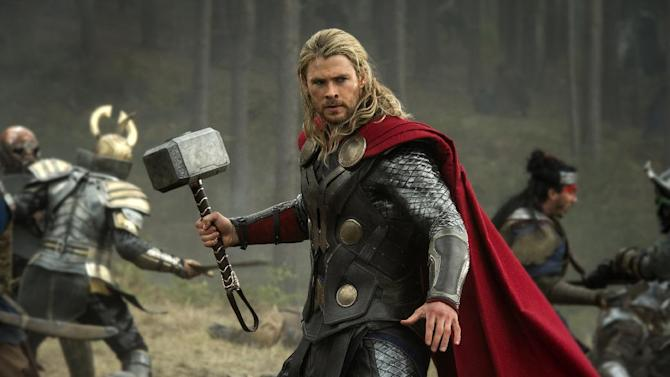 """FILE - This publicity file photo released by Walt Disney Studios and Marvel shows Chris Hemsworth in a scene from """"Thor: The Dark World."""" """"Thor: The Dark World"""" continued its box-office reign with $38.5 million in its second week, holding off """"The Best Man Holiday,"""" according to studio estimates Sunday, Nov. 17, 2013. (AP Photo/Walt Disney Studios/Marvel, Jay Maidment, File)"""
