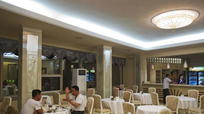 In this Sept. 7, 2012 photo, people have dinner in a newly-built restaurant in Pyongyang, North Korea. (AP Photo/David Guttenfelder)