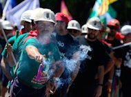 &lt;p&gt;A Spanish coal miner holds a firecracker during a demonstration on July 11, in Madrid, in protest at industry subsidy cuts that they say threaten their communities.&lt;/p&gt;