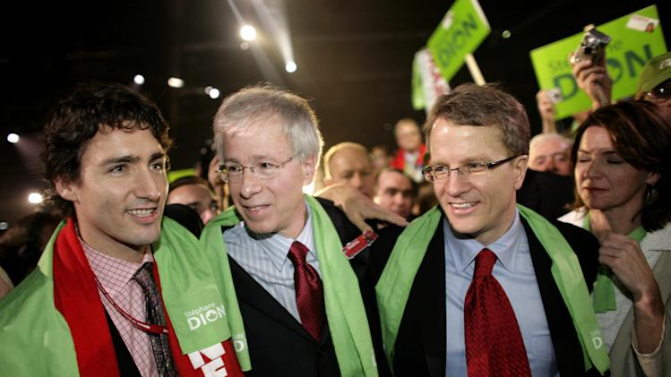MONTREAL - DECEMBER 2: Newly elected Liberal Party Leader Stephane Dion (C) is congratulated by Gerard Kennedy (R) and Justin Trudeau (L) after delivering his victory speech at the Palais de congres in Montreal, Quebec, Canada. Dion will lead the Liberals into the next election against Stephen Harper's Conservatives. (Photo by Simon Hayter/Getty Images)