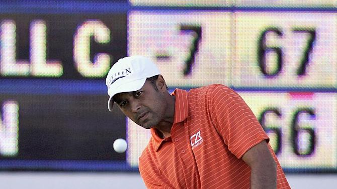 CORRECTS TO NINTH GREEN NOT 18TH GREEN - Arjun Atwal, of India, chips onto the ninth green during the second round of The McGladrey Classic PGA Tour golf tournament on Friday, Oct. 19, 2012, in St. Simons Island, Ga. (AP Photo/Stephen Morton)