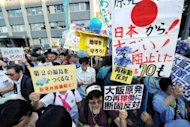 Tens of thousands of people rallied outside the Japanese prime minister's residence in Tokyo, in one of the largest demonstrations held against the restart of nuclear reactors