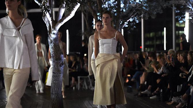 Models catwalk creations by Australian fashion designer Dion Lee during his show for Australian Fashion Week in Sydney
