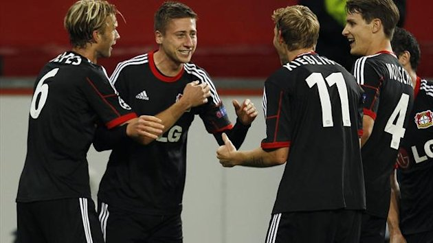 Bayer Leverkusen's Simon Rolfes, Jens Hegeler, Stefan Kiessling and Philipp Wollscheid celebrate a goal against Real Sociedad during their Champions League Group A soccer match at BayArena in Leverkusen October 2, 2013. REUTERS