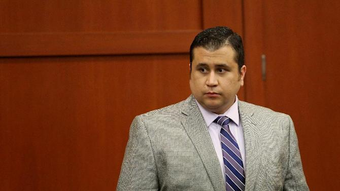 George Zimmerman leaves the courtroom court for the day in his trial in Seminole circuit court in Sanford, Fla. on Thursday, June 27, 2013. Zimmerman has been charged with second-degree murder for the 2012 shooting death of Trayvon Martin. (AP Photo/Orlando Sentinel, Jacob Langston, Pool)