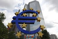 A giant logo of the Euro currency stands in front of the European Central Bank. European Central Bank head Mario Draghi insisted Thursday the embattled euro was &quot;irreversible&quot; but markets sold off sharply on disappointment he announced no immediate measures to tame the debt crisis