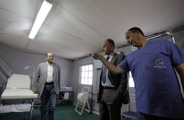 Francesco Fransoni, Italian ambassador to Jordan, center, tours the Italian Field Hospital for Syrian refugees, which was established in al-Mafraq city, Jordan, Tuesday, July 10, 2012. (AP Photo/ Moha