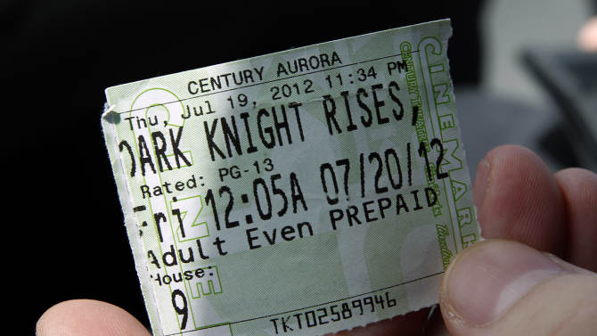 "Mike Campbell, from Aurora, shows his ticket from Century 16 theater Saturday, July 28, 2012, in Aurora, Colo. Campbell was in the theater when 12 people were killed and more than 50 wounded in a shooting attack early Friday, July 20, at the theater during a showing of the Batman movie, ""The Dark Knight Rises."" Police have identified the suspected shooter as James Holmes, 24. (AP Photo/Alex Brandon)"
