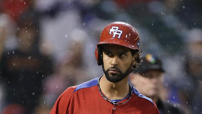 Puerto Rico's Angel Pagan walks to the dugout after striking out against Dominican Republic's Samuel Deduno during the fifth inning of the championship game of the World Baseball Classic in San Francisco, Tuesday, March 19, 2013. (AP Photo/Eric Risberg)