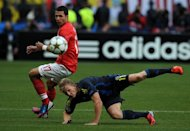 Players vie for the ball during Spartak Moscow&#39;s match against Fenerbahce in Moscow on August 21. Spartak Moscow on Thursday accused fans of their Champions League play-off rivals Fenerbahce of hacking into the club&#39;s website and threatening violence. The charges stemmed from a fiery first leg in Moscow on Tuesday, which the Russians won after their fans set fire to a portrait of Kemal Ataturk