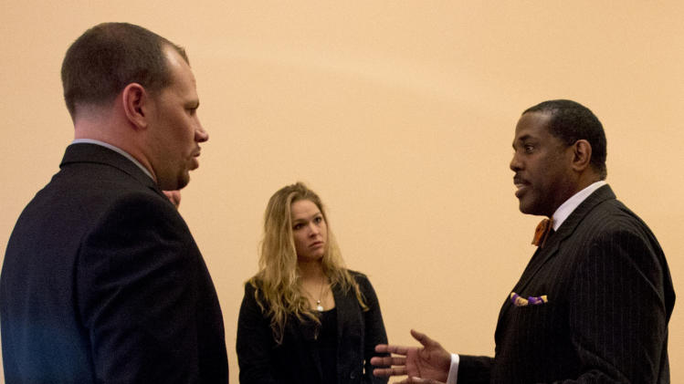 Sen. Kevin Parker, D-Brooklyn, right talks with mixed martial arts athletes Ronda Rousey, center, and Nick Catone at the Capitol in Albany, N.Y., on Wednesday, April 18, 2012. The state Senate is expected to approve legislation again to make New York the 46th state to legalize and regulate the sport, though opposition remains in the state Assembly. (AP Photo/Mike Groll)