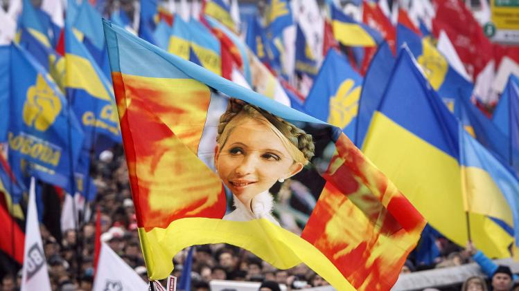 File photo of a flag with an image of Yulia Tymoshenko carried by protesters attending a rally to support EU integration in central Kiev