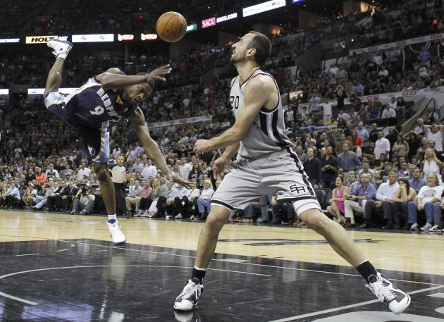 Spurs' Manu Ginobili fouls Grizzlies' Allen during the fourth quarter in Game 2 of their NBA Western Conference final playoff basketball series in San Antonio