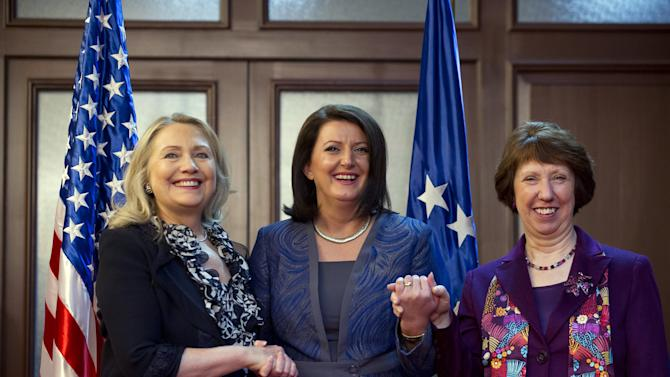 President Atifete Jahjaga of Kosovo, centre, shakes hands with US Secretary of State, Hillary Clinton, left, and High Representative for EU Foreign Policy, Catherine Ashton prior to a meeting at the Presidency in Pristina, Kosovo, Wednesday, Oct. 31, 2012. Clinton is to hold talks with Kosovo leaders to urge them to step up its efforts for EU and NATO integration in order to secure peace in the volatile Balkans region which she is touring. (AP Photo/Saul Loeb, Pool)
