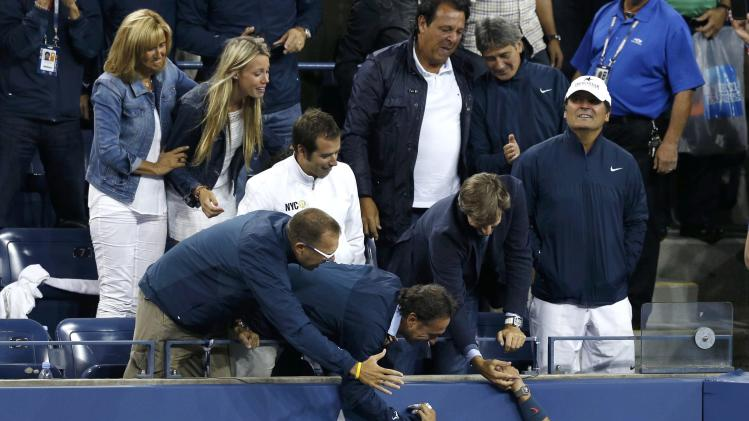 Nadal of Spain greets friends and family in the stands as he celebrates after defeating Djokovic of Serbia in their men's final match at the U.S. Open tennis championships in New York