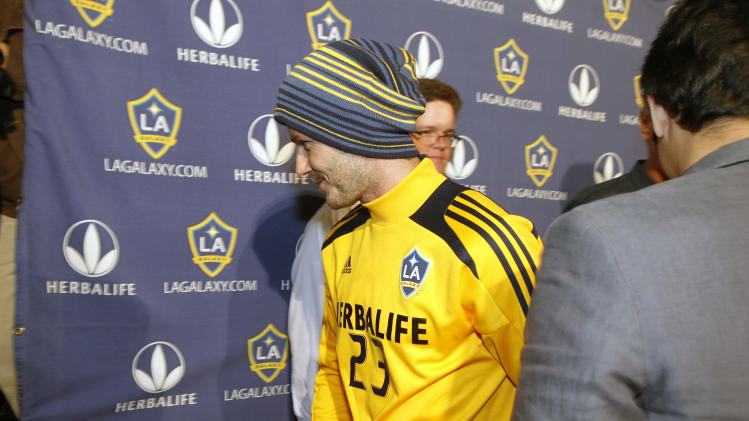 Los Angeles Galaxy's David Beckham, center, of England, walks off after talking with reporters during a news conference in Carson, Calif., Tuesday, Nov. 20, 2012.  Beckham will play his final soccer  game for the Galaxy in the MLS Cup next month. (AP Photo/Alex Gallardo)