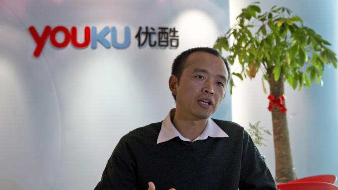 In this Thursday, Dec. 12, 2013 photo, Zhu Huilong, senior vice president of Youku Tudou, answers questions during an interview at the Youku headquarters in Beijing, China. In China, pirate DVDs in stores and on the street were traditionally the fastest way to get access to a film, and cheaper than going to the theater. A few years ago, piracy also dominated online. Today, China's major video streaming sites have deals with Hollywood studios and others and are filled with licensed content. To protect their investments, a group of video sites announced in November they had teamed up with the Motion Picture Association of America to sue other Chinese sites they accuse of copyright violations. (AP Photo/Ng Han Guan)