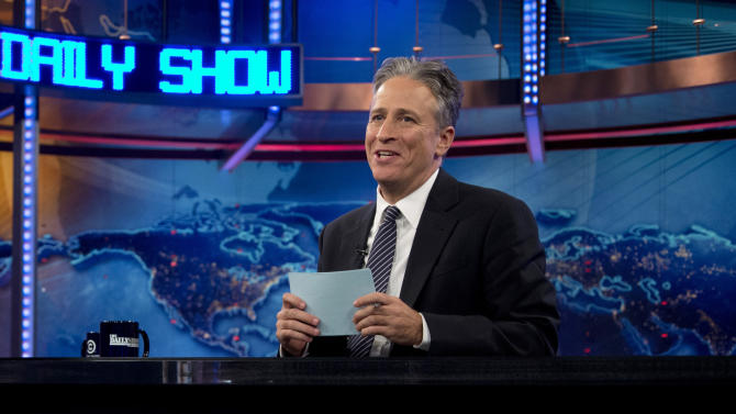 """FILE - This Oct. 18, 2012 file photo shows host Jon Stewart during a taping of """"The Daily Show with John Stewart"""", in New York.  Comedy Central says Jon Stewart will take a break from """"The Daily Show"""" starting in June to direct and produce his first feature film. The network said Tuesday, March 5, 2013 that correspondent-writer John Oliver will host the fake news show for the eight weeks of original episodes scheduled during Stewart's hiatus. The British-born Oliver has been a """"Daily Show"""" regular since 2006. (AP Photo/Carolyn Kaster, file)"""