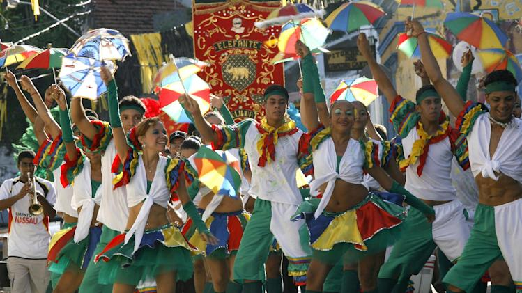 Members of the Bloco de Frevo group perform during a carnival parade in Olinda, in Brazil's northern Pernambuco state, Jan. 25, 2008. Frevo, the most popular rhythm of Pernambuco's carnival, turns 100 yeas and the Mangueira group, one of Brazil's best loved samba groups, will present a mix of samba and frevo during the Rio de Janeiro's carnival. (AP Photo/Eraldo Peres)