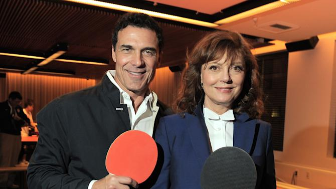 This Dec. 11, 2012 photo shows hotelier André Balazs, left, and actress Susan Sarandon at the opening of SPiN ping pong club at The Standard Hotel in Los Angeles. The newest SPiN club takes over the entire second floor of the trendy Standard Hotel in downtown L.A., boasting a custom-designed red table as its centerpiece. Professional instructors are available to teach the basics to those who didn't grow up with a table in their basements and to help amateurs perfect their skills. (Photo by Jordan Strauss/Invision/AP)