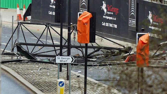A section of a damaged crane lays on the ground after a helicopter crashed into the crane on top of a building in central London, Wednesday Jan. 16, 2013. Police say two people were killed when a helicopter crashed Wednesday during rush hour in central London after apparently hitting a construction crane on top of a building. (AP Photo/PA, John Stillwell) UNITED KINGDOM OUT  NO SALES  NO ARCHIVE