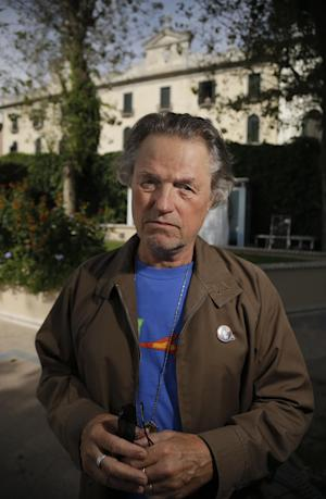 FILE - In this Aug. 30, 2012 file photo, film director Jonathan Demme poses for a portrait at the 69th edition of the Venice Film Festival in Venice, Italy. Wallace Shawn participated in a Jewish Voice for Peace video earlier this week along with other celebrities like Public Enemy rapper Chuck D and the Academy Award-winning director Demme and Nobel Peace Prize laureates that showed dozens holding up signs with the names of Palestinian killed in the violence. Demme feels much the same way as Wallace - that he's a passive participant in the attacks because of his status as a U.S. citizen - and says he's never thought once about holding back his feelings. (AP Photo/Domenico Stinellis)