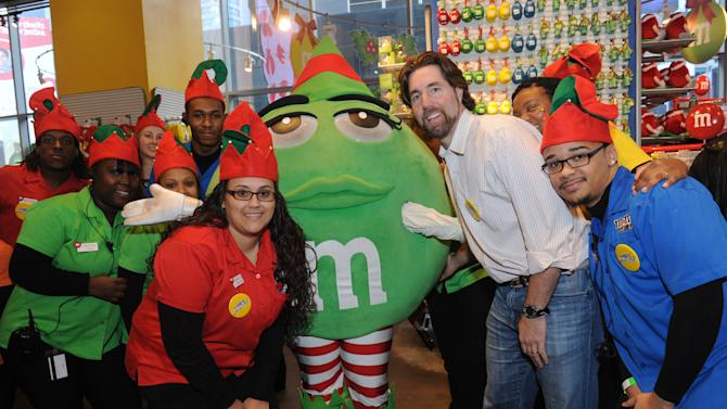 IMAGE DISTRIBUTED FOR M&M's WORLD - Cy Young Award winning pitcher R.A. Dickey greets the M&M's team during the unveiling of the Holiday Village at M&M's World in New York, Tuesday, Dec. 11, 2012.  The new M&M's World Holiday Village offers a variety of seasonal-themed merchandise including dispensers, clothing, ornaments and holiday-themed M&M's Brand Chocolate Candies. (Diane Bondareff/Invision for M&M's World/AP Images)