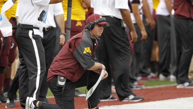 Minnesota head coach Jerry Kill kneels on the sidelines during the second quarter of an NCAA college football game against Western Illinois in Minneapolis, Saturday, Sept. 14, 2013. (AP Photo/Ann Heisenfelt)