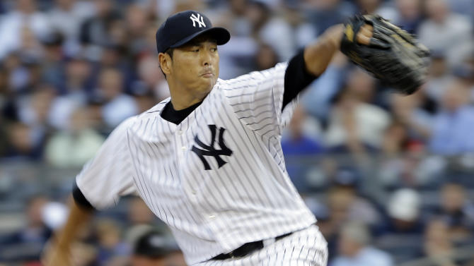 FILE - In this Oct. 14, 2012, file photo, New York Yankees pitcher Hiroki Kuroda throws in the first inning of Game 2 of the American League championship series against the Detroit Tigers in New York. Kuroda agreed to a $15 million, one-year contract with the Yankees Tuesday, Nov. 20. (AP Photo/Matt Slocum, File)