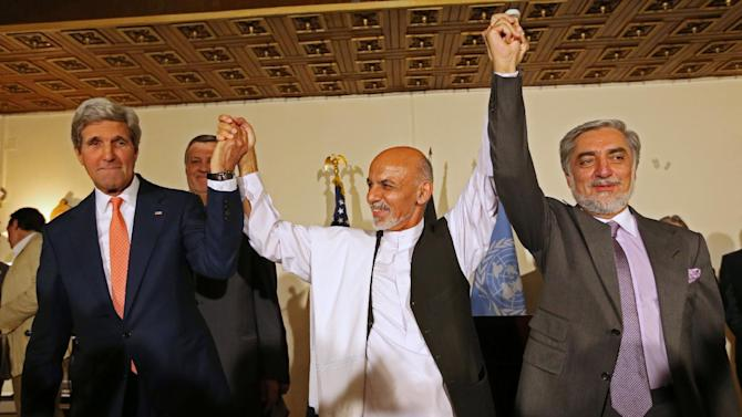 This July 12, 2014 file photo shows. from left, Secretary of State John Kerry, Afghanistan's presidential candidate Ashraf Ghani Ahmadzai, and Afghan presidential candidate Abdullah Abdullah during a joint news conference in Kabul, Afghanistan. The Obama administration on Thursday stepped up efforts to press Afghanistan's two feuding presidential candidates to end their dispute over June elections, accept the results of an ongoing audit of all ballots and form a national unity government by early September. On an unannounced visit to Kabul, Kerry made personal appeals to both candidates _ former Foreign Minister Abdullah Abdullah and former Finance Minister Ashraf Ghani Ahmadzai _ to understand the urgency of finding a resolution before the upcoming NATO summit in Wales on September 4, according to officials traveling with Kerry. (AP Photo/Rahmat Gul, File)