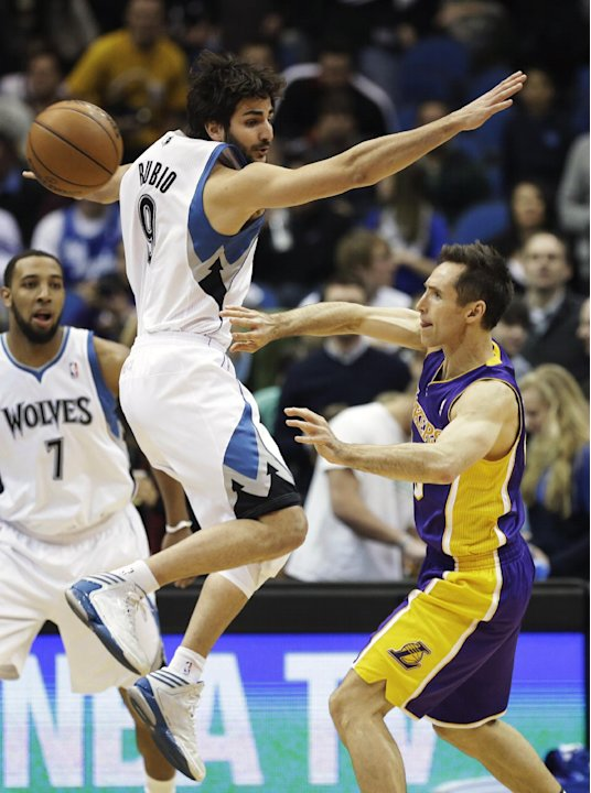 Minnesota Timberwolves' Ricky Rubio, left, of Spain, goes high to defend but Los Angeles Lakers' Steve Nash gets off a pass in the first quarter of an NBA basketball game, Friday, Feb. 1, 2013, in Min