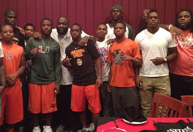 Platinum-selling rapper Rick Ross hangs out with the Washington High football team — Instagram