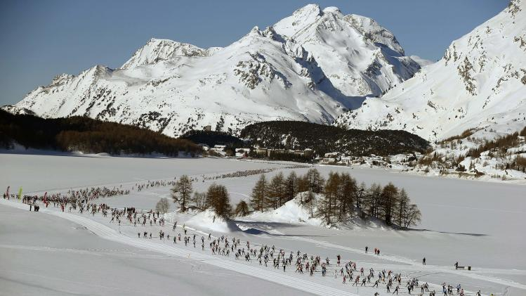 An aerial view shows cross country skiers racing over the frozen Lake Silsersee during the 46th Engadin Ski Marathon near the village of Maloja