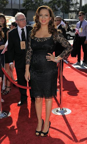 FILE - In this Sat., Sept. 15, 2012 file photo, Maya Rudolph arrives at the 2012 Creative Arts Emmys at the Nokia Theatre in Los Angeles. Rudolph, nominated for a 2012 Emmy, says jokingly a bottle of champagne helps calm award show nerves. (Photo by Chris Pizzello/Invision/AP, File)