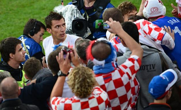 Croatian Forward Mario Mandzukic (L) Reacts AFP/Getty Images