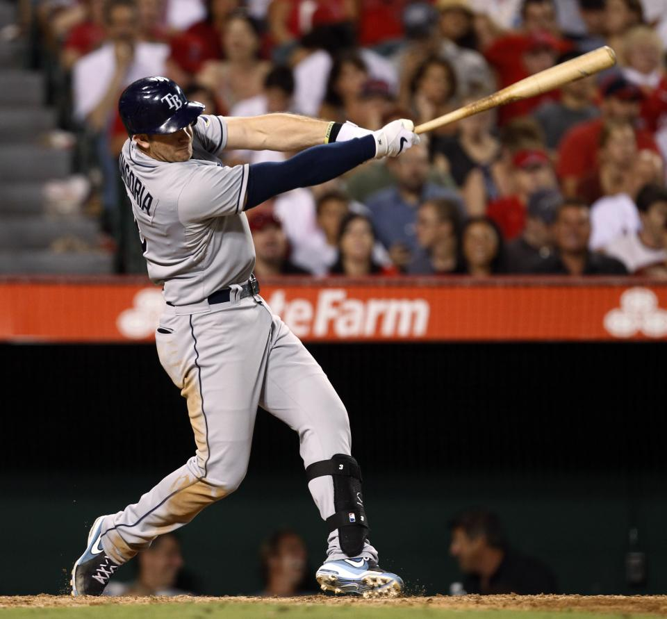 Tampa Bay Rays' Evan Longoria hits a two-run home run in the fifth inning of a baseball game against the Los Angeles Angels in Anaheim, Calif., on Saturday, Aug. 18, 2012. (AP Photo/Christine Cotter)