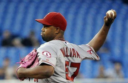 Los Angeles Angels' Jerome Williams pitches against the Toronto Blue Jays in the first inning of their MLB American League baseball game in Toronto