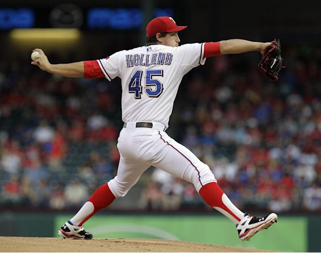 Texas Rangers starting pitcher Derek Holland (45) throws during the first inning of a baseball game against the Baltimore Orioles, Wednesday, Aug. 22, 2012, in Arlington, Texas. (AP Photo/LM Otero)