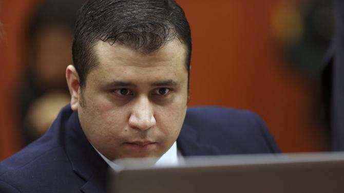 George Zimmerman looks at information on a laptop during jury selection in his trial in Seminole circuit court in Sanford, Fla., Thursday, June 20, 2013. Zimmerman has been charged with second-degree murder for the 2012 shooting death of Trayvon Martin.(AP Photo/Orlando Sentinel, Gary Green, Pool)
