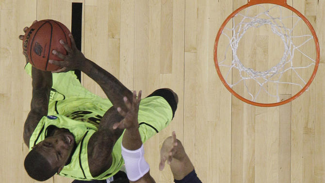 Baylor's Logan Lowery (20) shoots under pressure from Xavier's Tu Holloway (52) and Xavier's Travis Taylor right during the first half of an NCAA South Regional semifinal college basketball tournament game Friday, March 23, 2012, in Atlanta. (AP Photo/David J. Phillip)
